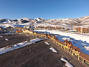 SHOT 3/2/17 7:42:56 AM - Aerial photos of Park City, Utah. Park City lies east of Salt Lake City in the western state of Utah. Framed by the craggy Wasatch Range, it's bordered by the Deer Valley Resort and the huge Park City Mountain Resort, both known for their ski slopes. Utah Olympic Park, to the north, hosted the 2002 Winter Olympics and is now predominantly a training facility. In town, Main Street is lined with buildings built primarily during a 19th-century silver mining boom that have become numerous restaurants, bars and shops. (Photo by Marc Piscotty / © 2017)