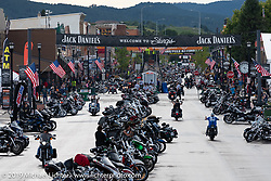 Main Street from the east tower during the Sturgis Black Hills Motorcycle Rally. Sturgis, SD, USA. Saturday, August 10, 2019. Photography ©2019 Michael Lichter.