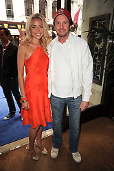 NOELLE RENO and SCOT YOUNG at the Ralph Lauren Wimbledon Party held at Ralph Lauren, 1 New Bond Street, London on 17th June 2010.