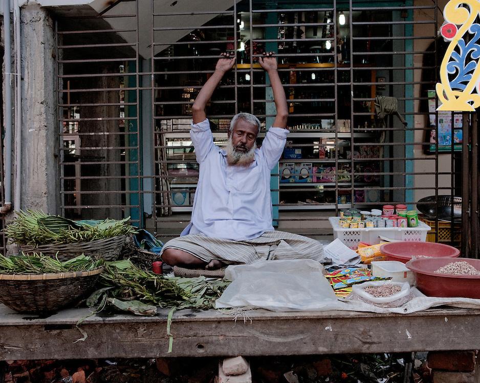 Portrait of market trader in Dhaka