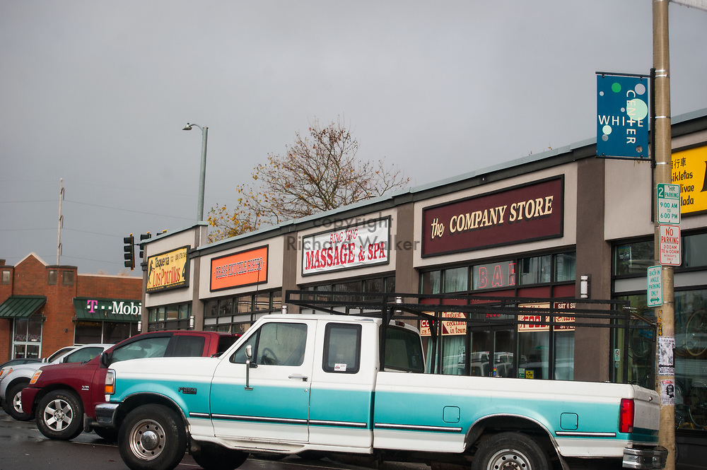 2017 NOVEMBER 20 - Businesses and cars on 16th Ave SW in White Center, Seattle, WA, USA. By Richard Walker