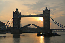 © Licensed to London News Pictures. 28/09/2013. Iconic Tower Bridge against an Autumn sunrise. Credit : Rob Powell/LNP