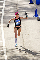 NYC Marathon, Deena Kastor, 41, USA, smiles and waves to the crowd as she finishes 11th