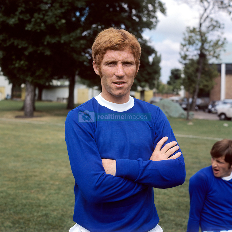 England International Alan Ball poses for a head shot, much to the boredom of teammate Tommy Wright (r).