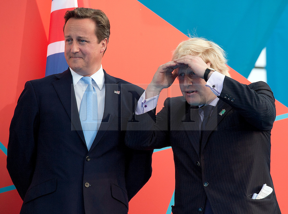 **FILE PICTURE- David Cameron and Boris Johnson will will campaign against each other ahead of an EU Referendum on June 23rd, 2016**© Licensed to London News Pictures. 27/07/2011. LONDON, UK. The Mayor of London, Boris Johnson (L) and the British Prime Minister, David Cameron, stand together at a ceremony in Trafalgar Square as London marks one year to go to the 2012 London Olympic Games. Photo credit : Matt Cetti-Roberts/LNP