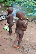 Central African Republic. August 2012. Batalimo. Pk6 - Aka (Biaka) people/ pygmies or 'citizens' as they would rather be known. Two toddlers with stomachs swoollen from worms.