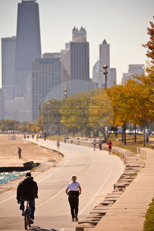 Bicyclists and joggers along Lake Michigan in downtown Chicago, IL.