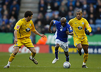 Photo: Steve Bond/Richard Lane Photography. Leicester City v Sheffield Wednesday. Coca Cola Championship. 12/12/2009. Lloyd Dyer (C)  goes past Leon Clarke (R) and Lewis Buxton (L)