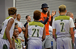 July 21, 2017 - Charlotte, NC, USA - NBA star LeBron James, center/facing camera, encourages his son, LeBron Jr. and his teammates during youth tournament action at the Charlotte Convention Center in Charlotte, N.C., on Friday, July 21, 2017. (Credit Image: © Jeff Siner/TNS via ZUMA Wire)