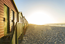 April 7, 2015 - View along a row of colourful wooden beach huts on a long sandy beach at sunrise. (Credit Image: © Mint Images via ZUMA Wire)
