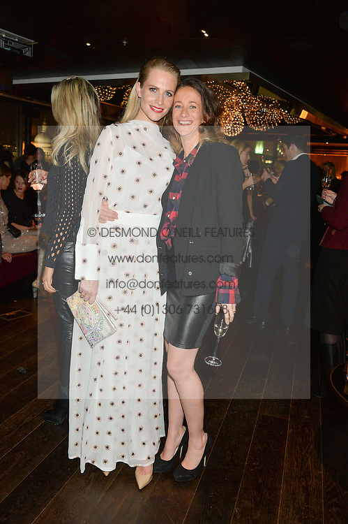 Left to right, POPPY DELEVINGNE and LEAH WOOD at the Launch Of Osman Yousefzada's 'The Collective' 4th edition with special guest collaborator Poppy Delevingne held in the Rumpus Room at The Mondrian Hotel, 19 Upper Ground, London SE1 on 24th November 2014, sponsored by Storm models and Beluga vodka.