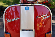 "Classic (antique) red Piaggio Vespa ""150 Super"" scooter, circa 1960. Da Lat, Vietnam"