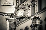 Clock and lantern, Piazza San Giovanni, Florence, Tuscany, Italy