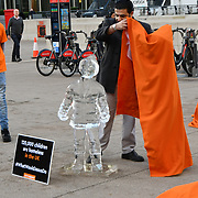 "Penny Appeal Team Orange unveiling 5 life-size ice statues ""What Would Jesus Do?"", symbolising homeless families to promote their winter campaign. The frozen family will depict the plight of the 140* families who become homeless everyday, and the 900* children who become homeless every month on 17th December at Canary Wharf, London, UK."