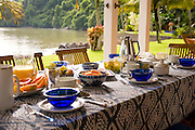 Private home in Parati Brazil. Back terrace, overlooking the sea, with the table set for breakfast.