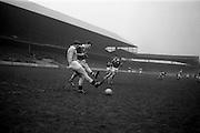 16/02/1964<br /> 02/16/1964<br /> 16 February 1964<br /> Railway Cup Football Semi Final: Munster v Ulster at Croke Park, Dublin. Ulster full back L. Murphy and Munster forward M. Burke run for the ball.