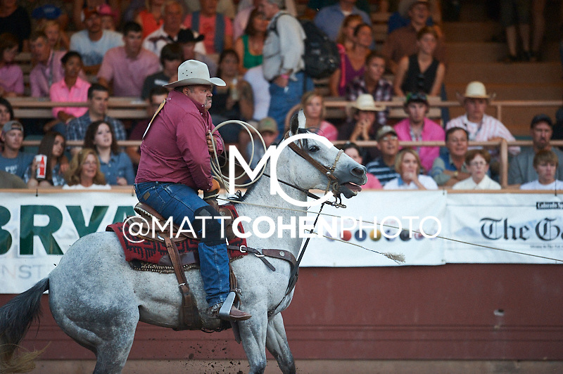 Team roper Bill Bond of Parker, CO competes at the Pikes Peak or Bust Rodeo in Colorado Springs, CO.<br /> <br /> <br /> UNEDITED LOW-RES PREVIEW<br /> <br /> <br /> File shown may be an unedited low resolution version used as a proof only. All prints are 100% guaranteed for quality. Sizes 8x10+ come with a version for personal social media. I am currently not selling downloads for commercial/brand use.