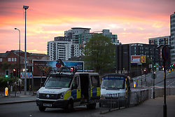 © Licensed to London News Pictures. 23/05/2017. Manchester, UK. Sunrise as viewed from Trinity Way , opposite the Manchester Arena . Police and other emergency services are seen near the Manchester Arena after reports of an explosion. Police have confirmed they are responding to an incident during an Ariana Grande concert at the venue. Photo credit: Joel Goodman/LNP