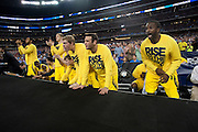 The University of Michigan Wolverines look on in the final minutes against the University of Kansas Jayhawks during the NCAA South Regionals at Cowboys Stadium in Arlington on Friday, March 29, 2013. (Cooper Neill/The Dallas Morning News)