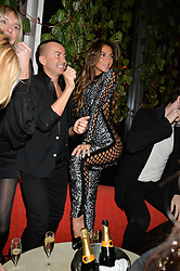 JULIEN MACDONALD and NICOLE SHERZINGER at a party to celebrate the first anniversary of SushiSamba at the Heron Tower, 110 Bishopsgate, London EC4 on 12th November 2013.