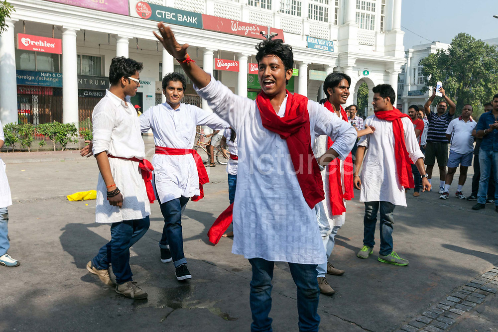 Actors perform a political play about acid attacks during a Raahgiri Day. Raahgiri Day is India's first sustained car-free citizen initiative that started in Gurgaon but has since spread across India. Here, Connaught Place is closed to traffic and community events are held. New Delhi, India