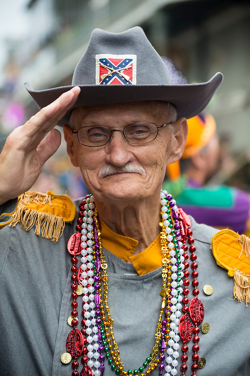 A senior man in a Confederate military uniform costume salutes on Bourbon Street during Fat Tuesday festivities in New Orleans, Louisiana.