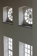 Light comes in through pretty windows of the Design Museum in Ghent, Belgium