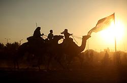 September 16, 2016 - Dair Al Balah, Gaza Strip, Palestinian Territory - Palestinians ride camels during a Bedouin festival in Dair Al Balah in the central Gaza Strip September 16, 2016  (Credit Image: © Ashraf Amra/APA Images via ZUMA Wire)