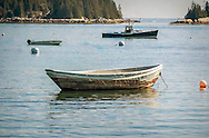 Image of an old Dory anchored off the Stonington coast in October.