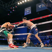 Puerto Rican Olymian Jeyvier Cintron (R) knocks Edson Noria to the canvas during a Telemundo boxing match between at Osceola Heritage Park on Friday, February 23, 2018 in Kissimmee, Florida.  (Alex Menendez via AP)