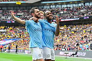Goal - Raheem Sterling (7) of Manchester City celebrates scores a goal to give a 5-0 lead with Bernardo Silva (20) of Manchester City and has three finger up to show the trebble winners during the The FA Cup Final match between Manchester City and Watford at Wembley Stadium, London, England on 18 May 2019.