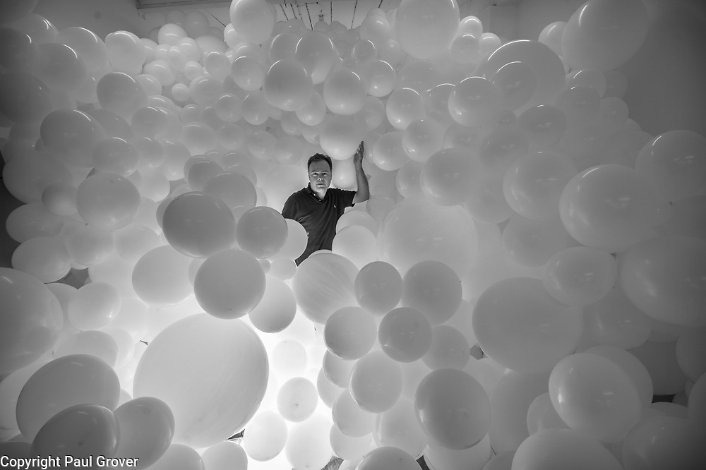 Charles Petillon artist and his installation 'Heartbeat' composed of 100,000 balloons being installed in the South Hall