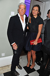 NICKY HASLAM and ELLA KRASNER at a champagne reception to launch The Big Egg Hunt presented by Faberge in aid of the charities Action for Children and Elephant Family held at 29 Portland Place, London on 18th January 2012.