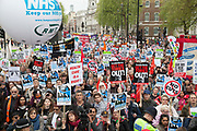 London, UK. Saturday 18th May 2013. Protestors listen to speakers during a demonstration against NHS reform and proposed funding cuts for services within the National Health Service.