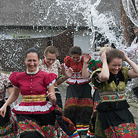 Women wearing traditional dresses of the Matyo people run from buckets of water splashed on them as part of the fertility traditions during the Easter watering celebration in Mezokovesd (about 130 km East of capital city Budapest), Hungary on April 13, 2017. ATTILA VOLGYI