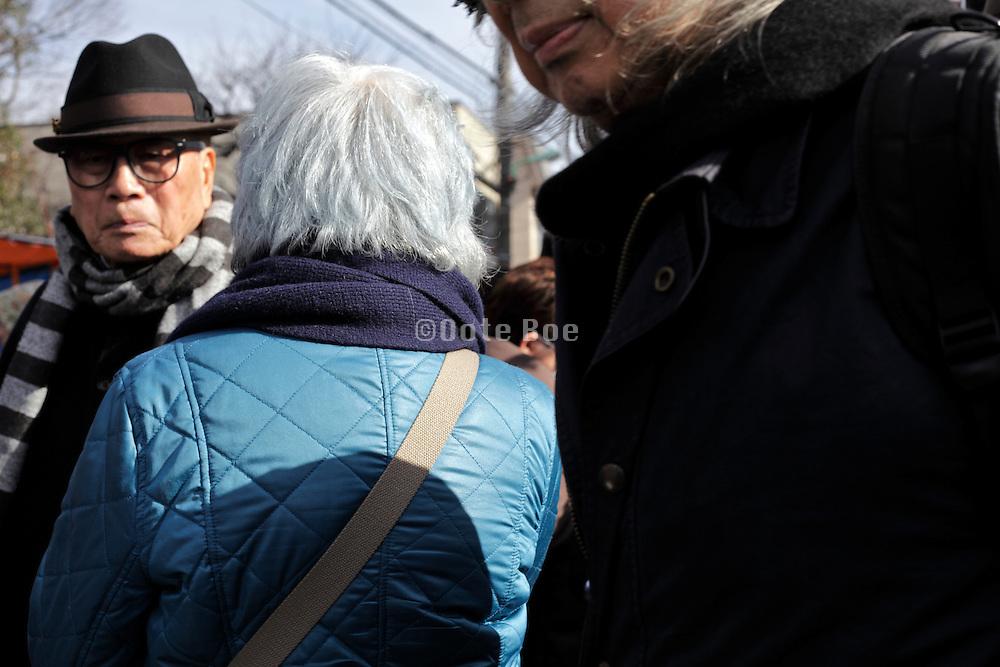 elderly people meeting in the street Tokyo Japan