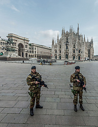 March 22, 2020, Milan, Italy: Army soldiers enforce a Coronavirus COVID-19 emergency stay-at-home decree by checking passengers at the gates to access trains at Milan Piazza Duomo to verify the actual need to move. (Credit Image: © Carlo Cozzoli/Fotogramma/ROPI via ZUMA Press)