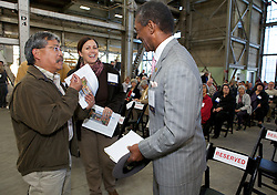 Newly elected  City Council member, Bob Sampayan, Vallejo City Council member Stephanie Gomes and Mayor Osby Davis laugh as Blu Homes opens their West Coast factory on Mare Island in Vallejo, California Dec. 1, 2011.  Over 400 guests attended a ribbon cutting ceremony at the 250,000-square-foot facility.