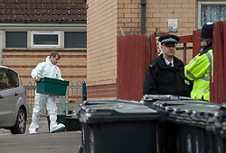 © Licensed to London News Pictures.  03/03/2015, Bristol, UK.  Police forensics officers go to a house after private ambulance leaves Barton Court, Barton Hill during the search for missing teenager Rebecca Watts aged 16 who left home a mile away in Crown Hill in the St George area of Bristol last Thursday. Police have carried out extensive searches across Bristol and today said they had found body parts in Barton Court. Up to 7 people have now been arrested in connection with the case with 2 arrested on suspicion of the murder of Becky Watts, having previously been arrested on suspicion of kidnapping her.  Photo credit : Simon Chapman/LNP