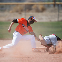 Gallup Bengal shortstop Ukiah Smith tags Grants Pirate Jared Villasana out on an attempted steal at second base during their varsity baseball game Tuesday afternoon in Gallup.
