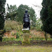 A statue on the Statue Walk wrapped up to protect it from the winter weather, Newby Hall estate and gardens, Ripon, North Yorkshire, UK