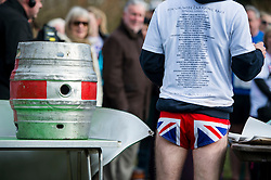 © Licensed to London News Pictures. 06/03/2016. Dorking, UK. A beer barrel sits on a table as a prize for the winners as the winners are announced. Competitors take part in the 2016 Wife Carrying Race in Dorking, Surrey.  The race, which is run over a course of 380m, with both men and women carry a 'wife' over obstacles,  is believed to have originated in the UK over twelve centuries ago when Viking raiders rampaged into the northeast coast of  England carrying off any unwilling local women .  Photo credit: Ben Cawthra/LNP