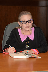 December 27, 2016 - File - CARRIE FRANCES FISHER (October 21, 1956 - December 27, 2016) was an American actress, screenwriter, author, producer, and speaker. She was known for playing Princess Leia in the Star Wars films. Fisher was also known for her semi-autobiographical novels, including Postcards from the Edge, and the screenplay for the film of the same name, as well as her autobiographical one-woman play, and its nonfiction book, Wishful Drinking, based on the show. Her other film roles included Shampoo (1975), The Blues Brothers (1980), Hannah and Her Sisters (1986), The 'Burbs (1989), and When Harry Met Sally (1989). Pictured: November 28, 2016 - Los Angeles, CA, United States - Carrie Fisher..at the Carrie Fisher book signing for ''The Princess Diarist,'' Barnes & Noble, Los Angeles, CA 11-28-16. (Credit Image: © Martin Sloan/Avalon via ZUMA Press)