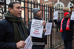 London, UK. 6 December, 2019. A small group of activists holding placards highlighting offensive terms and descriptions used in the past by Prime Minister Boris Johnson protests outside the headquarters of the Conservative party.