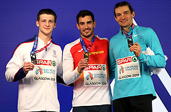 Great Britain's Tim Duckworth (left), Spain's Jorge Urena, and Ilya Shkurenyov celebrate with their medals at the Men's Heptathlon during day three of the European Indoor Athletics Championships at the Emirates Arena, Glasgow.