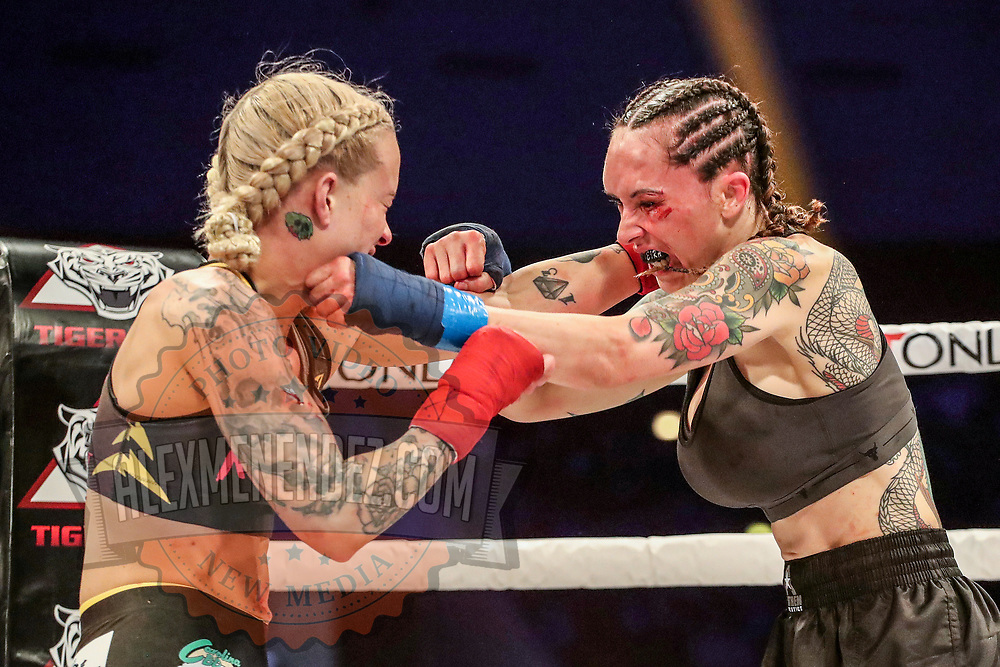TAMPA, FL - FEBRUARY 05: Taylor Starling (L) fights against Charisa Sigala during the BKFC KnuckleMania event at RP Funding Center on February 5, 2021 in Tampa, Florida. (Photo by Alex Menendez/Getty Images) *** Local Caption *** Charisa Sigala; Taylor Starling
