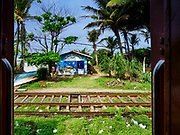 06 OCTOBER 2017 - DEHIWALA, WESTERN PROVINCE, SRI LANKA: The train from Colombo to Galle rolls through the countryside south of Colombo.    PHOTO BY JACK KURTZ