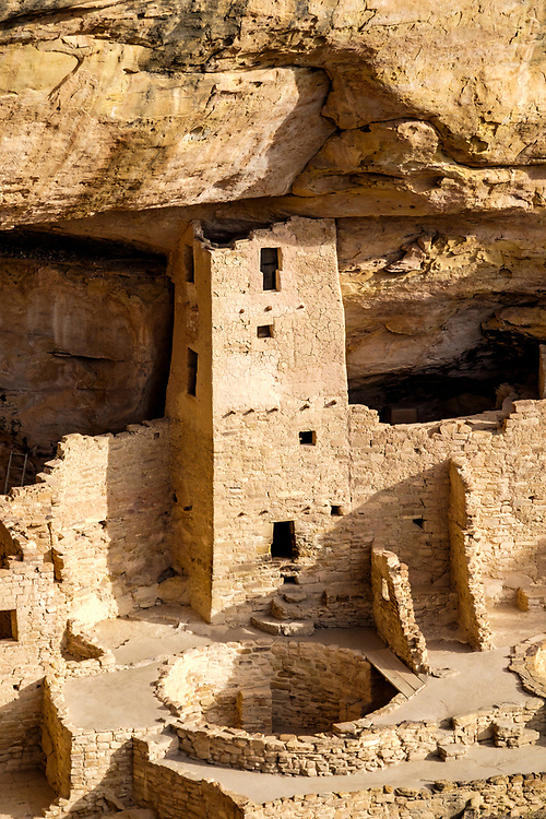 A round Kiva can be seen in front of one of the more impressive towers.