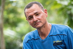"""16 November 2018, San José de León, Mutatá, Antioquia, Colombia: """"My dream, it is to see this country in peace,"""" says Joverman Sánchez Arroyave, formerly known by the name of war Rubén Cano, as commander in the FARC guerrilla (Revolutionary Armed Forces of Colombia). """"I dream that what was agreed in Havana, witnessed by the international community, is fulfilled. That is the whole essence, to achieve the political transformation that is needed in our country, including peace."""" Following the 2016 peace treaty between FARC and the Colombian government, a group of ex-combatant families have purchased and now cultivate 36 hectares of land in the territory of San José de León, municipality of Mutatá in Antioquia, Colombia. A group of 27 families first purchased the lot of land in San José de León, moving in from nearby Córdoba to settle alongside the 50-or-so families of farmers already living in the area. Today, 50 ex-combatant families live in the emerging community, which hosts a small restaurant, various committees for community organization and development, and which cultivates the land through agriculture, poultry and fish farming. Though the community has come a long way, many challenges remain on the way towards peace and reconciliation. The two-year-old community, which does not yet have a name of its own, is located in the territory of San José de León in Urabá, northwest Colombia, a strategically important corridor for trade into Central America, with resulting drug trafficking and arms trade still keeping armed groups active in the area. Many ex-combatants face trauma and insecurity, and a lack of fulfilment by the Colombian government in transition of land ownership to FARC members makes the situation delicate. Through the project De la Guerra a la Paz ('From War to Peace'), the Evangelical Lutheran Church of Colombia accompanies three communities in the Antioquia region, offering support both to ex-combatants and to the communities"""