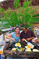 Cooking breakfast at Blacktail Canyon campsite, Whitewater rafting trip (oar trip) on the Colorado River in Grand Canyon, Grand Canyon National Park, Arizona USA
